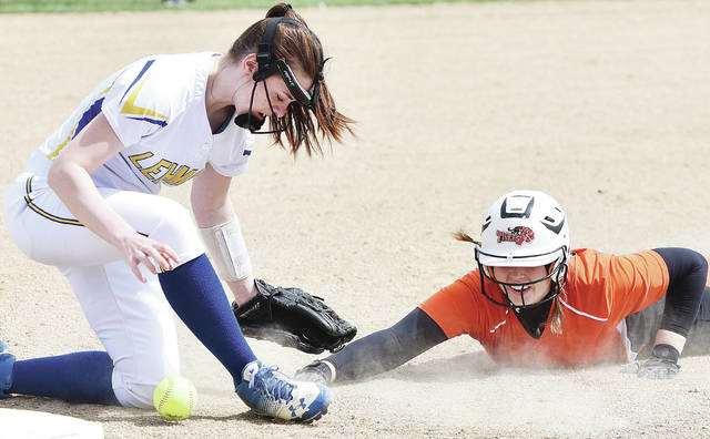 Lehman Catholic's Grace Brandt reaches for the ball as Jackson Center's Riley Jackson loses momentum on her slide towards third during a nonconference game on Saturday in Sidney. Jackson was tagged out on the play.