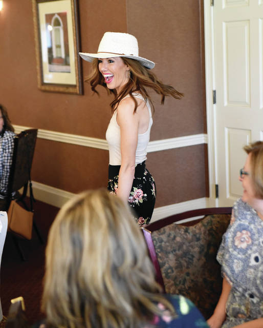 Stephanie Cost, POWER Advisory Board Member, models some the current fashions during the Power of the Purse United Way fundraiser at the Piqua Country Club Saturday, April 13.
