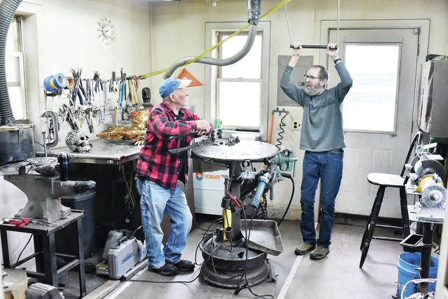 Sculptor Gary Hovey, right, talks with his friend of 35 years Jim Perrine, both of New Knoxville, in Hovey's workshop. Perrine sometimes helps Hovey work on his sculptures.