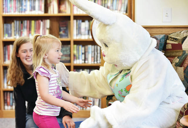 Emma Schulze, 3, of Anna, daughter of Brian and Kay Schulze, walks towards the Easter Bunny for a hug. Watching is Easter Bunny helper Lauren Thornhill, 15, of Anna, daughter of Carin and Ron Thornhill. during an Easter event at the Anna Community Branch Library Saturday, April 20. Harper is also the daughter of Dusting Fox. The Easter Bunny was part of an Easter event at the Anna Community Branch Library Saturday, April 20.