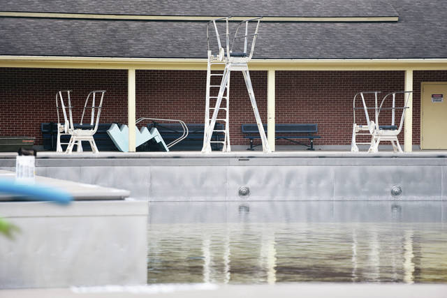 Rain water fills the Sidney Municipal Pool Friday, April 26. Sidney Parks and Recreation Department staff is hoping to fill the lifeguard chairs with lifeguards for the upcoming swimming season.