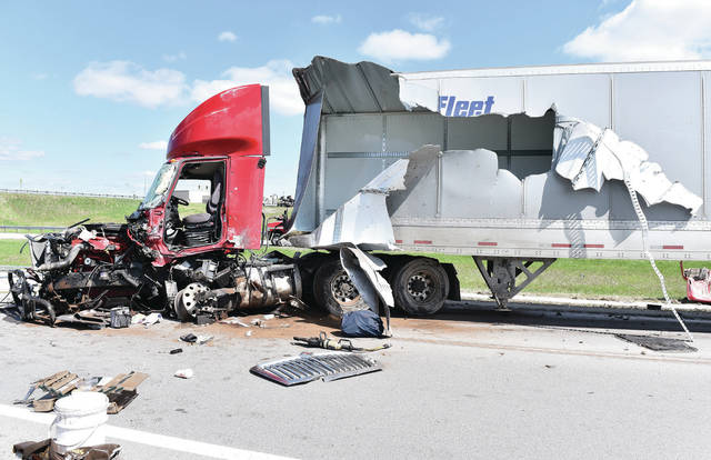 A semi trailer's cab was destroyed and its trailer torn open from a crash involving at least one other semi trailer.