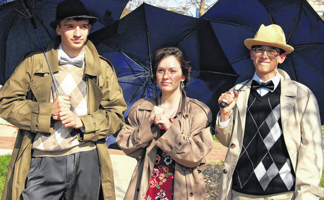 """Zach Baughman, left, as Cosmo Brown, Melody Joines as Kathy Selden and Isaiah Abbott as Don Lockwood rehearse a scene from """"Singin' in the Rain Jr.,"""" which will be performed by students of the Christian Academy Schools at the school in Sidney, Friday and Saturday."""