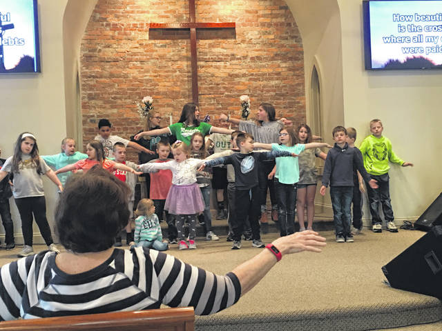 "Children's Ministry Coordinator Janice Locker leads the children choir members from Botkins and Anna United Methodist Churches in a rehearsal for ""O Happy Day."" The musical will be performed Sunday, April 14, at 2 p.m. at the Anna church."