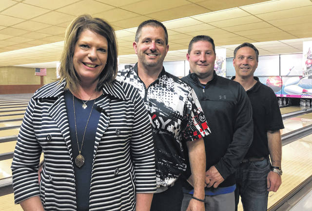 Community Lanes in Minster has new owners. Pictured (l-r) are new owners Lori Davidson, Doug Davidson, Steve Henry and Mike Henry.