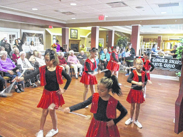 Ginny's Ginger Snaps entertain at Elmwood Assisted Living in New Bremen, recently.
