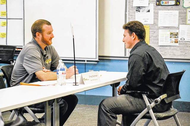 Greg Dickman, left, of Slagle Mechanical Inc., interviews Michael Frank, a Sidney High School student, during Workforce Partnership of Shelby County's Industry Interview Day at the school, April 16.