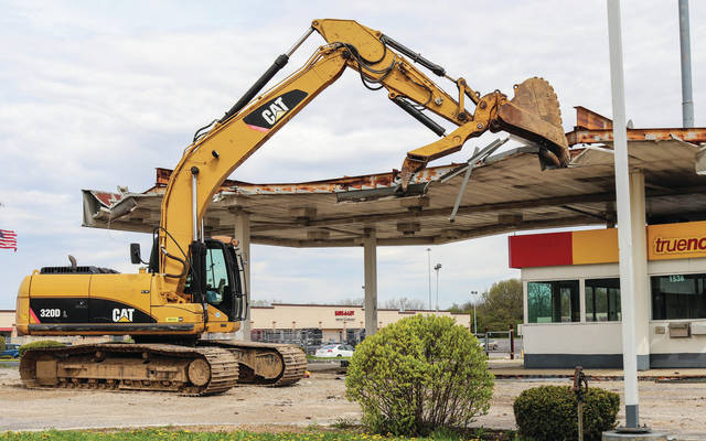The old Shell gas station makes way for O'Reilly Auto Parts.