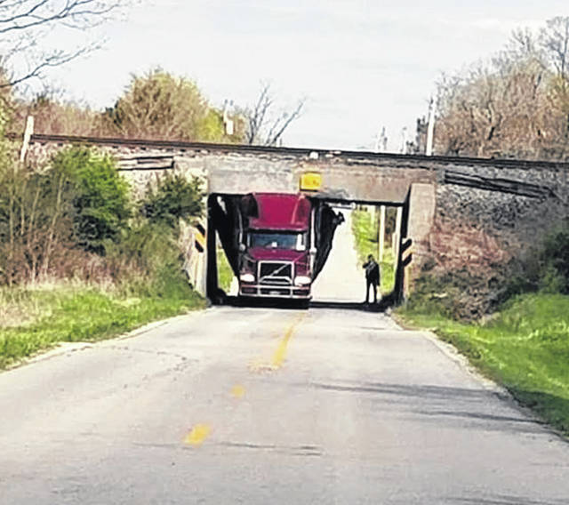A semitrailer is stuck under the railroad tracks after hitting the Mason Road bridge in Franklin Township on Sunday at 3:27 p.m. The truck driver, Farris J. Ward, 54, of Arnold, Missouri, was cited with a stop light or stop sign violation.