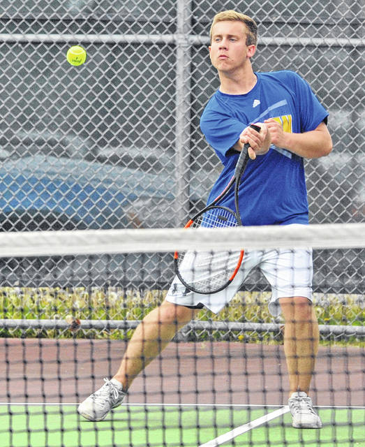 Lehman Catholic's Cole Kramer hits a return in doubles match during the Division II sectional tournament on Tuesday in Troy.