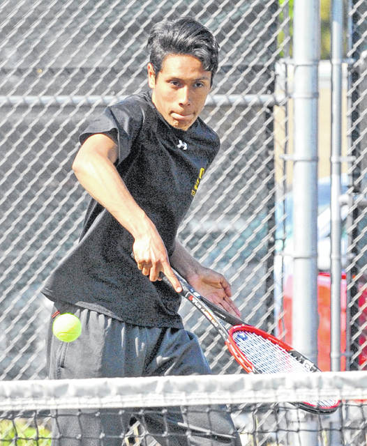 Sidney's Jersain Brux hits during a Division I sectional match on Wednesday in Troy. Brux and partner Broc Bey lost 6-0, 6-0 to Troy in a second-round match.