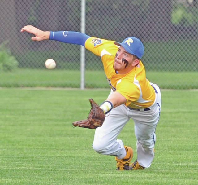 Russia senior center fielder Jordan York makes a diving catch in the fourth inning of the Raiders' 3-1 district final win over Newton on Wednesday in Versailles. It was one of several big defensive plays that aided starting pitcher Evan Monnier's performance.