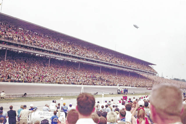"As race fans get ready for this year's Indianapolis 500, Sidney resident Caven Risk shared a photo his dad, Bill Risk, took 50 years ago. ""This is the race that put Mario Andretti in the history books. He won the 1969 Indy 500 in a backup car after crashing his primary car and burning his face. Mario went on to win the Daytona 500 and become only the second American to win the Formula One World Championship,"" said Caven Risk. The photo contains the Goodyear Blimp in the background and below it is the checkered flag waving."