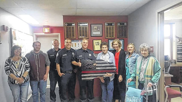 The Landings of Sidney honored members of the Sidney Fire Department Friday by serving them a spaghetti dinner in honor of International Firefighters Day, which is May 4. They also presented the department with a metal sign made by resident Julie Pleiman. As a thanks for the gift, Pleiman, with assistance from Margaret Mowery,Landings management staff, got to sit in one of the fire trucks.