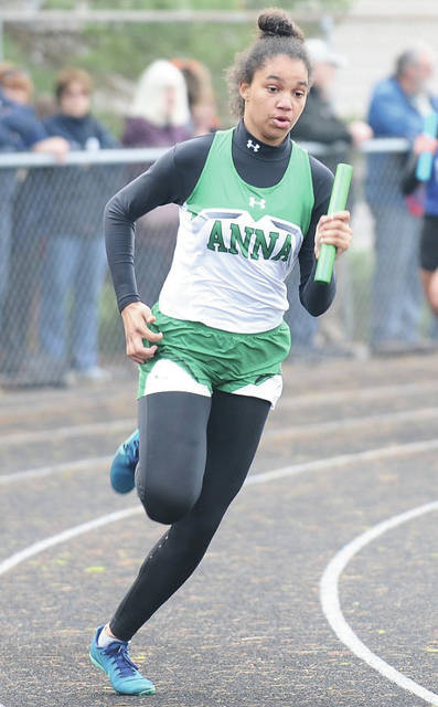 Anna's Kaitlyn Harris sprints the final leg on the Rockets' winning 800 relay team during the Covington Invitational on Friday in Covington.