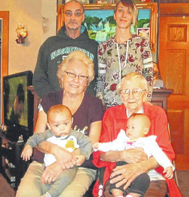 Five generations of the Lewis family recently posed for a photo. They are, back row, grandfather Bobby Lewis and daughter Ashley Lewis, mother of the twins pictured. Great-grandmother Connie Kay Lewis, front left, of Sidney, holds baby Jeramiah, 6 months, while great-great-grandmother Marjoie Brackney, of Port Jefferson, holds twin sister Anniyah, 6 months.