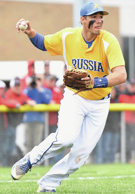 Russia third baseman Carter Francis throws to first during a Division IV district semifinal on Monday in Sidney.
