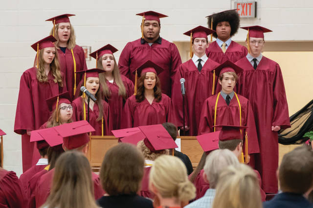 New Bremen seniors sing in the school choir for the last time during the New Bremen graduation Sunday, May 26.