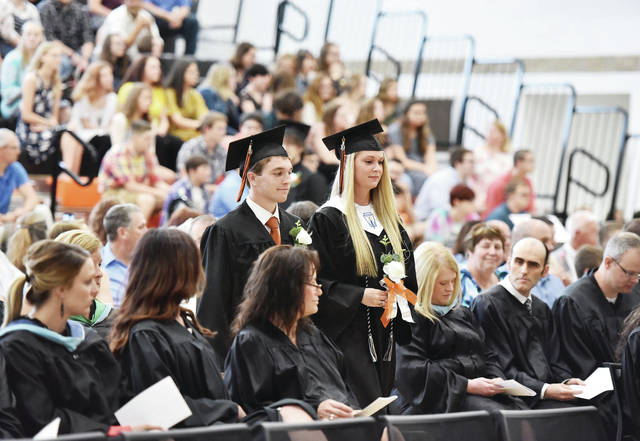 Jackson Center seniors take part in their graduation ceremony processional Sunday, 19.