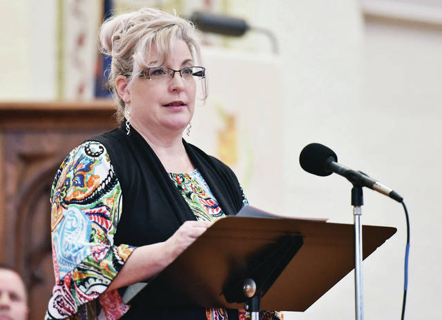 Deanna Stienecker says a prayer for families, workplaces, and communities to love one another during the National Day of Prayer Shelby County Celebration held at St. Johnճ Lutheran Church Thursday.