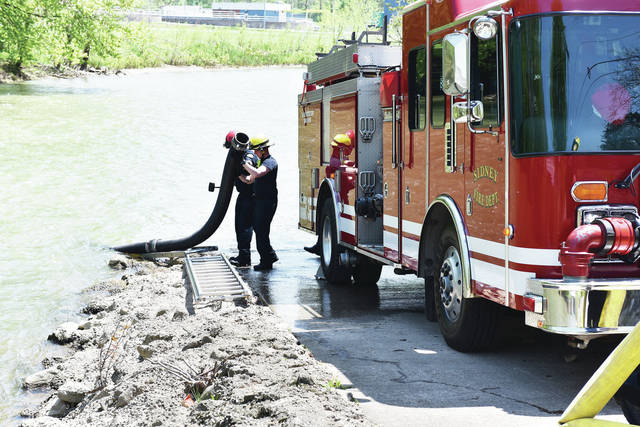 Sidney fire fighters pumped water from the great Miami River using one fire engine to pump the water to a second fire engine which then dispensed the water through different hoses.