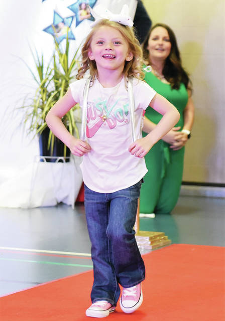 Austyn Phillips, 4, of Sidney, Daughter of Darrell & Keerstin Porter and Joseph Phillips, walks down the red carpet during the Fashion Show Extravaganza put on by The Shelby County Board of Developmental Disabilities at the Sidney-Shelby County YMCA Saturday, May 4.