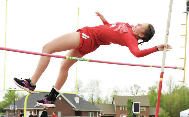 Houston's Mariah Booher competes in girls pole vault during the Shelby County Athletic League meet on Friday in Fort Loramie.