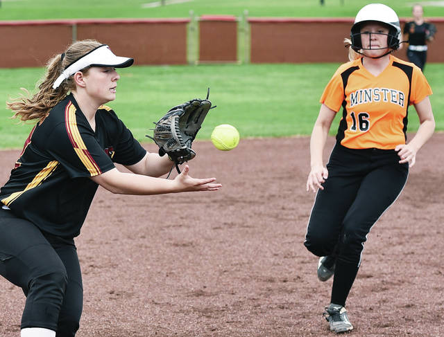 New Bremen's Kelly Naylor catches a throw to third as Minster's Laney Hemmelgarn approaches during a Midwest Athletic Conference game on April 18 in New Bremen. Minster was voted the No. 1 seed in the Wapakoneta district while New Bremen was voted No. 2. Luke Gronneberg | Sidney Daily News