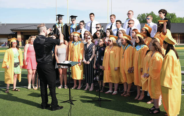 Sindey High School seniors perform with the Sidney High Choir during their graduation ceremony Saturday, May 25.