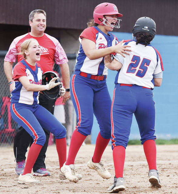 Riverside's Jalynn Stanley jumps at Kalin Kreglow as they celebrate a 3-2 win over Lehman Catholic in a Division IV sectional final on Thursday in DeGraff. Stanley scored the winning run after Kreglow hit a single to right field.
