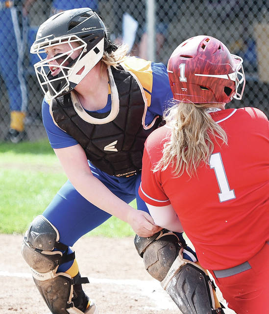 Russia catcher Riley Hammonds tags out Houston's Emilee Foster in the second inning of a Shelby County Athletic League game on Saturday in Russia.