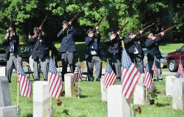 A rifle salute is performed by a combined color guard Sidney Veterans Association under the direction of American Legion Post 217 during a Memorial Day service at Graceland Cemetery Monday, May 27.