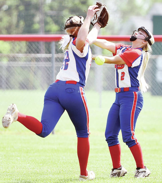 Riverside's Shelby Giles, left, and Jordyn Marshall try to catch a fly ball during a Division IV district final against National Trail on Saturday in Tipp City.