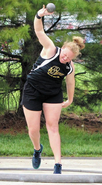 Sidney's Emma Wiford competes in shot put during the Division I district meet at Alexander Stadium in Piqua on May 16, 2018. Wiford just missed earning a regional berth and is hoping to this season.