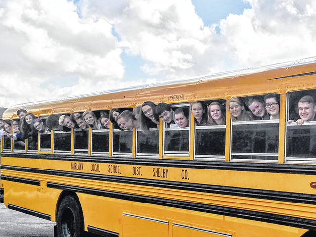 Fairlawn Local Schools students ham it up on the bus taking them to a choir contest, recently.