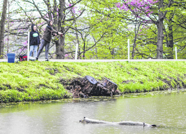 Shaylee Leet, 14, daughter of Brandy Slate, of Sidney and Joshua Leet, of Dayton, and Ryan North, 15, son of Ashley Murray, of Sidney, and Craig North, of Sidney, didn't let the rain deter them from fishing Saturday, May 4. The weekend was a free fishing program where fishermen didn't have to have a fishing license.