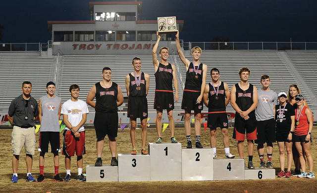 Fort Loramie's boys track and field squad celebrates winning the Division III regional championship on Friday in Troy.