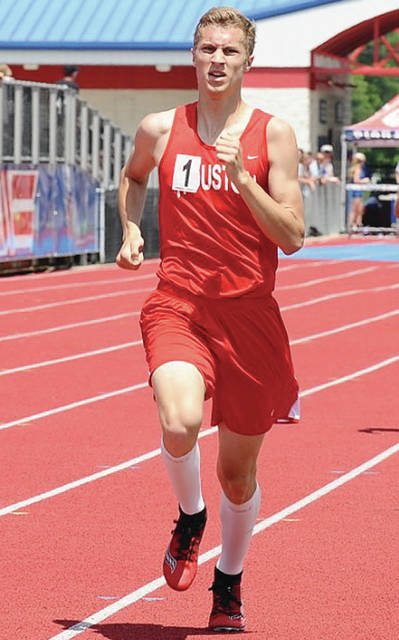 Houston's Ethan Knouff nears the finish line in the 800-meter run during the Division III district meet on Saturday at Alexander Stadium in Piqua.