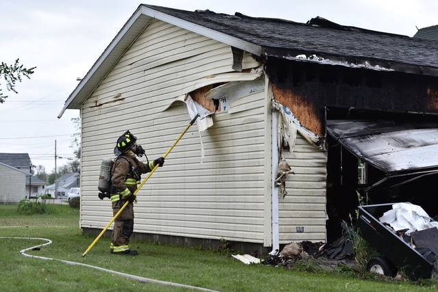 A garage fire at 603 College St. In Jackson Center Spread to the Inside of the house's roof Sunday afternoon. Firefighters from Jackson Center, Anna and Botkins responded to the scene. Holes were cut into the roof to reach the fire.