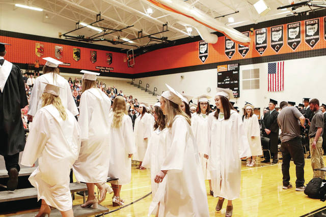 Versailles valedictorians enter on stage for the Versailles graduation ceremony Sunday, May 26.