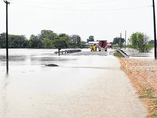 The Sidney Fire Department and its RIT-Craft rescue boat assisted the Botkins Volunteer Fire Department in rescuing a man who was trapped in his truck Friday morning as a result of high water at State Route 274 and Wenger Road.