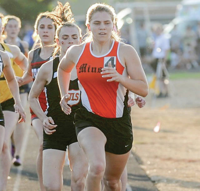 Minster senior Madeline Magoto leads the pack during the 800-meter run in the Division III regional meet on May 26 at Troy Memorial Stadium. Magoto, the daughter of Minster coach Jessie Magoto, has the top-seeded time in the 800 heading into this weekend's state meet.