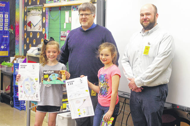 Engineers from the Allen County Engineer's Office visited New Bremen Elementary School on Monday afternoon to present prizes to winners of the Imagine Engineering Coloring Contest. Pictured are, front row, left to right, Maria Kramer, Lily Hiber, and back row, Scott Little and Ron Meyer.