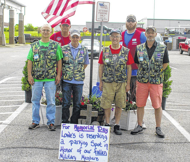 A parking space at Lowe's in Sidney has been dedicated to individuals who died serving in the military for Memorial Day weekend. Pictured are Lowe's employees, front row, left to right, Ron Simon, an Army veteran; Terry Wilcox, a Marine Corps veteran; Ed York, a Navy veteran; Tim Ritter, an Air Force veteran; back row, left to right, Ed Sauers, an Army and Marine Corps veteran; and Thomas Steiger, an Army veteran.