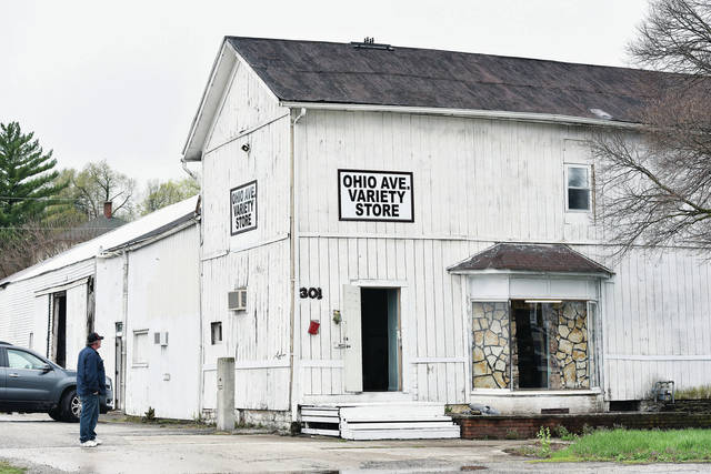 Doni Donaldson, of Sidney, looks at the outside of his store, Ohio Avenue Variety Store, which is located at 301 N. Ohio Ave.