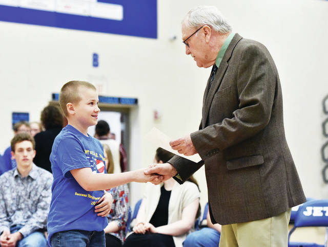 Fairlawn 5th grader Trenton Scherer, left, 11, of Sidney, son of Derek and Danielle Scherer, gets his DARE diploma from Shelby County Sheriff John Lenhart during a DARE graduation ceremony at Fairlawn Monday, May 6. The DARE program is run by the Shelby County Sheriff's Office. Shelby County Sheriff's Deputy Brian Strunk is the DARE Officer that teaches kids throughout Shelby County how to avoid drug use.