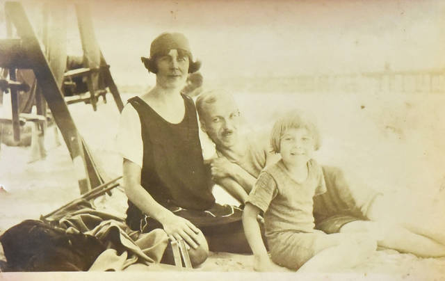 A picture of Jane Babbitt as a child on the beach with her parents next to the famous Steel Pier in Atlantic City.