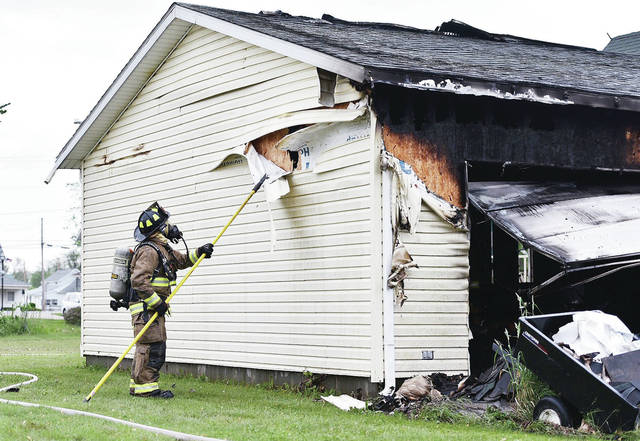 A garage fire at 603 College St. In Jackson Center spread to the inside of the house's roof Sunday afternoon. Firefighters from Anna, Botkins, Jackson Center and Van Buren Township responded to the scene. Holes were cut into the roof to reach the fire.