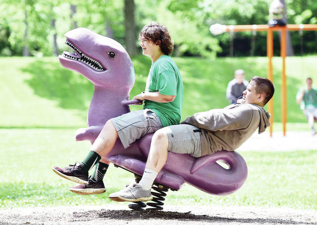 Riding a purple dinosaur at Tawawa Park Thursday, May 23, are Landon Cantrell, left, 14, of Houston, son of Jodi and Rick Cantrell, and Thaine Hamilton, 14, of Anna, son of Alex and Rebecca Hamilton. The two boys were at the park with a good portion of their Anna eighth-grade class for an incentive trip. Students could come on the trip if they met certain requirements based on their grades, behavior, attendance and assignment completion. The students also had a picnic.