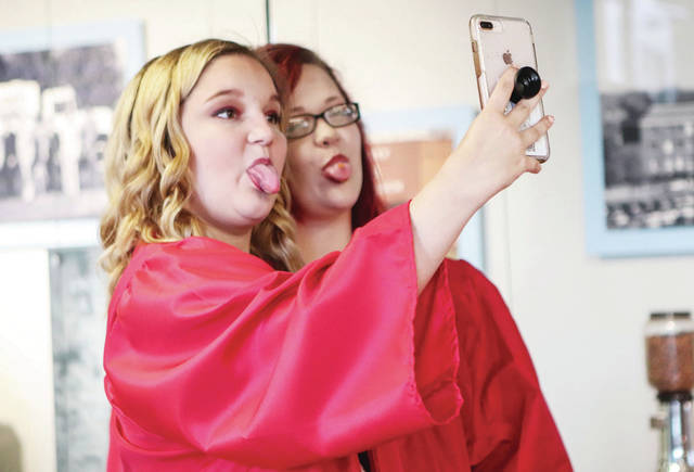 Jaina Burton, 18, and Ashlynn Burton, 18, both of Piqua, take a selfie together. They were in the Cosmetology class together and had Sara Plozay as their teacher. The Upper Valley Career Center graduation ceremony was held at the Hobart Arena in Troy Thursday, May 24.